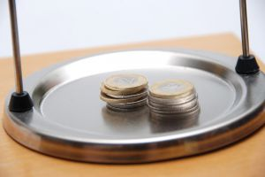 money-on-the-weighing-scale-1-1172390-m